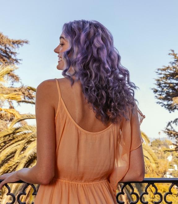 Woman with purple hair dye