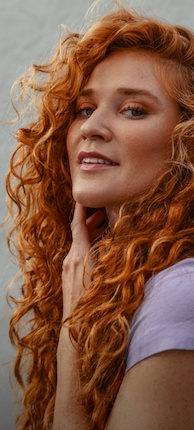 Woman with healthy looking and naturally curly red hair