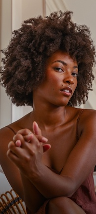 Woman with healthy looking and naturally curly black hair