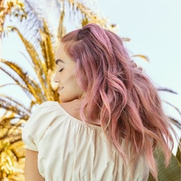 Woman with pink hair color